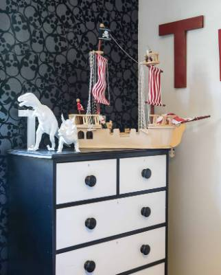 Marama painted the chest of drawers in Tamati's room with help from decorator Marcus Prenter.
