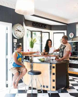 "Marama Durie, Colin McGrath and son Tamati in the kitchen; Colin does most of the cooking, says Marama: ""Lamb shanks are ..."