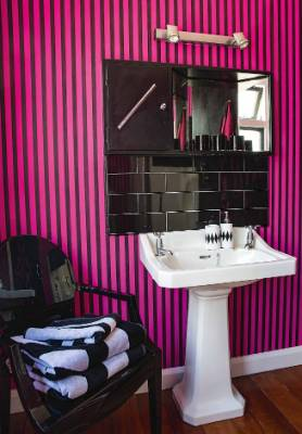 Christian Lacroix striped wallpaper in the main bathroom.