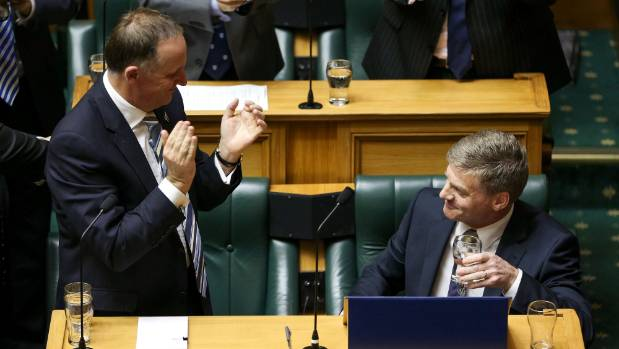 Finance Minister Bill English is applauded by Prime Minister John Key after axing the $1000 kickstarter from KiwiSaver ...