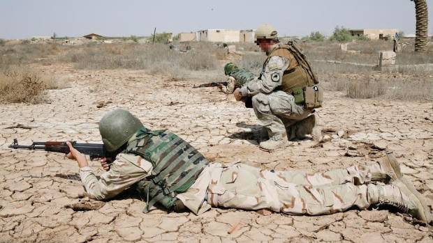 An NZDF trainer instructs Iraqi Security Forces soldiers in correct weapon positions at Camp Taji, in Iraq.