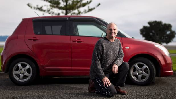 Wayne Stronach with his daughter's Suzuki Swift which arrived in the country fitted with snow tires.