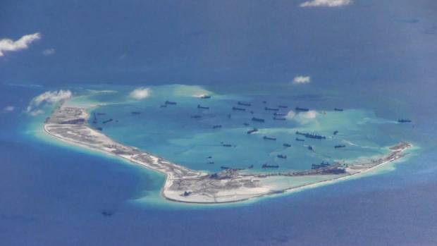 Chinese dredging vessels are purportedly seen in the waters around Mischief Reef in the disputed Spratly Islands in this ...
