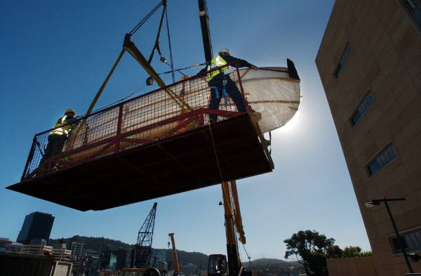 Antarctic explorer Ernest Shackleton's lifeboat, the James Caird, is craned into Te Papa in 2004.