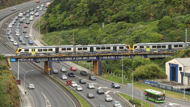 A train passes over the Ngauranga Gorge section of State Highway 1, north of Wellington.