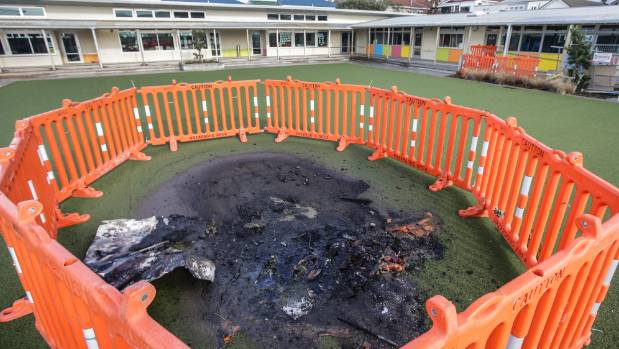 Security fences surround the artificial grass turf at Lyall Bay School damaged by an arsonist.