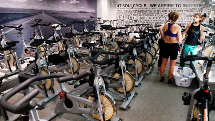fa531ca237c A fitness instructor speaks with participants of a SoulCycle class at their  Union Square location in