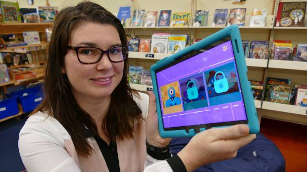 Invercargill Public Library digital content coordinator Eve Moodie checks out the app that children will use to code and ...