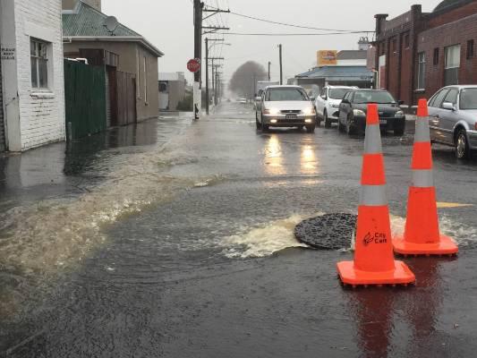 Heavy rain floods roads in south Dunedin.