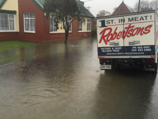 Surface flooding affects a street in Dunedin.
