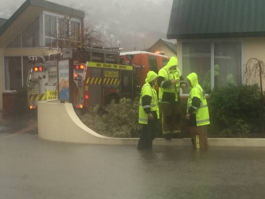 Firefighters work to protect Fulton rest home from surface flooding in south Dunedin.