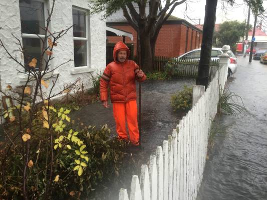 Surface flooding affects a property in south Dunedin.