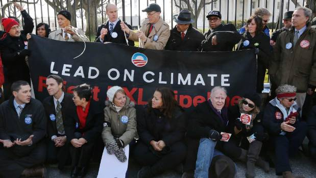 Sierra Club executive director Michael Brune, top row, fourth from left, and other activists opposed to the Keystone XL ...
