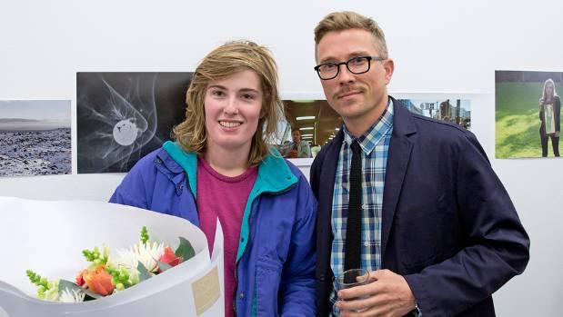University of Auckland student Elena Lochore-Ward, 21, with photography competition judge Simon Devitt.