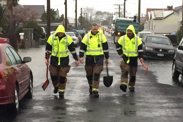 Firefighters help sandbag Richmond St in Dunedin.