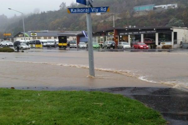 Waves of water Kaikorai Valley Road in Dunedin.