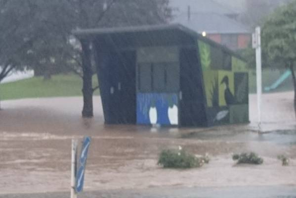 Flooding at the Stone St roundabout in Dunedin.