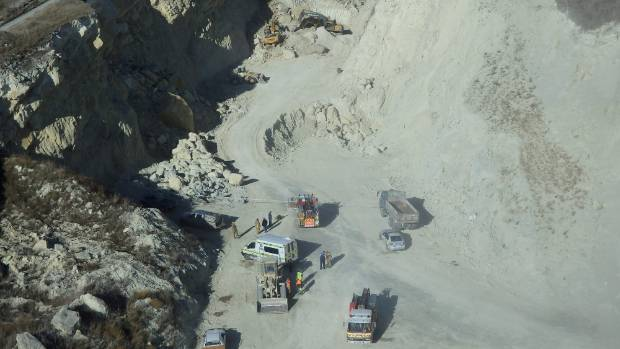 Emergency services congregate at an illegal quarry operated by Murray Taylor, 56, who was killed in a landslide at the ...