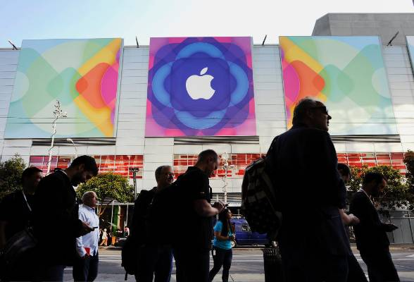 Aattendees line up to enter the Moscone Center before the start of the Apple World Wide Developers Conference in San ...