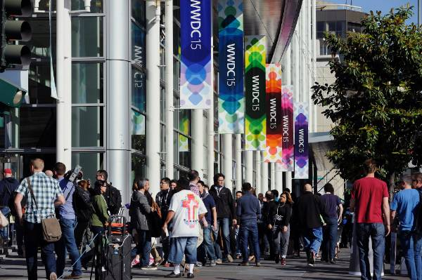 Attendees line up to enter the Moscone Center before the start of the Apple World Wide Developers Conference.