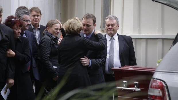 Lecretia Seales' husband Matt Vickers, in the blue shirt, is comforted after her funeral service at Old St Paul's in ...