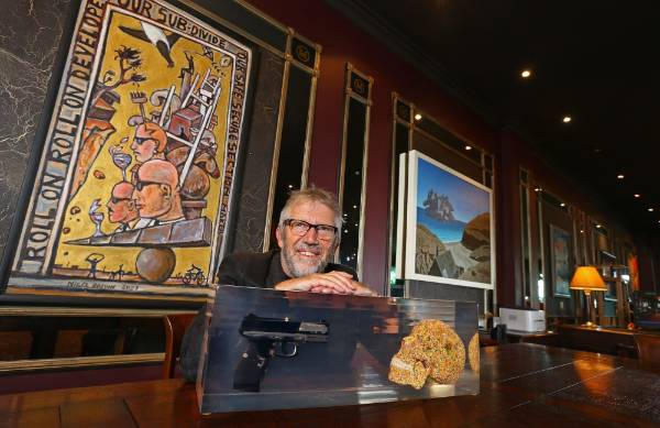 Wellington's Museum Hotel owner Chris Parkin with some of his art  works on show in the  lobby of the Museum Hotel.