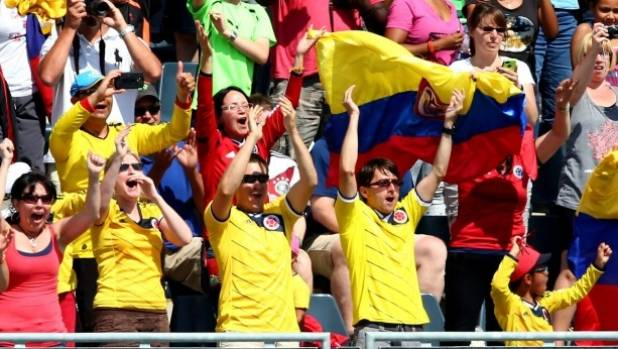 Two for one: Colombia fans celebrate in the second half against France.