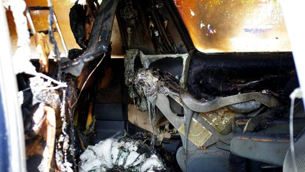 The inside of a van that was destroyed by a fire.