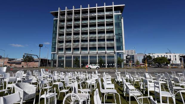 The IRD building in Madras street, with the 185 White Chairs installation in the foreground.