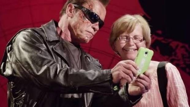 Steel, not wax: Arnold Schwarzenegger comes alive at Madame Tussauds to the delight of this fan.