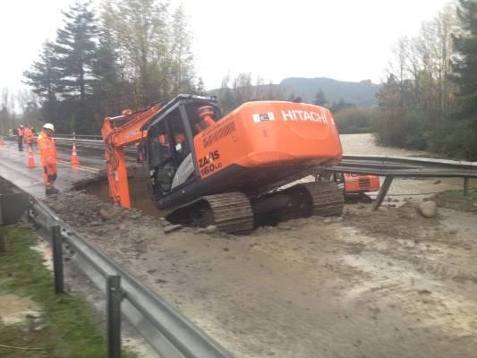 Workers begin repairs on the bridge.