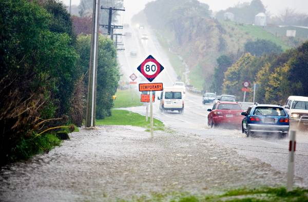 State Highway 3 south of Waitara has been affected by surface flooding.