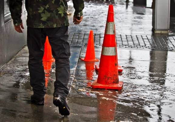 Raw sewage was flowing onto central New Plymouth streets after sewer mains were overwhelmed by stormwater.