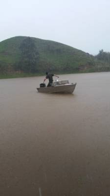 Nicole Smith sent this photo in of her boyfriend Kyle Siffleet and their puppy dog Mini boating on a flooded Mangaone ...