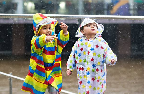 Twins Milan and Anjali Bhaskar, 2, donned their best raincoats for their ringside seats to New Plymouth's flooding at ...