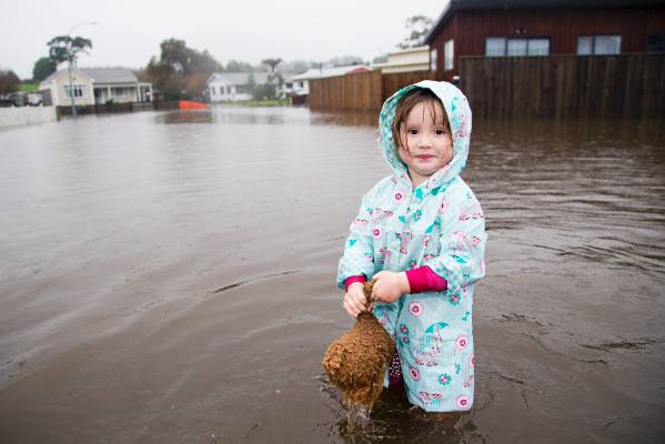 Shyanne Donghi-Johnson, 3, on in the flood waters on Makere St in Waitara.