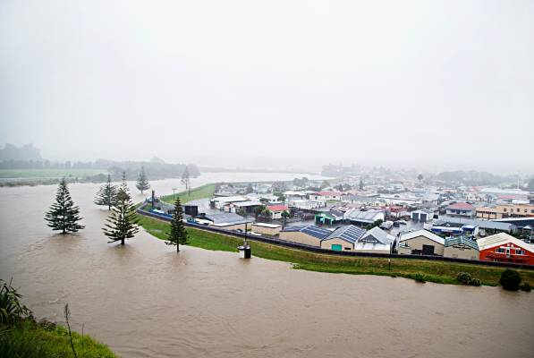 Heavy rain has caused the Waitara River rise and the town to flood.
