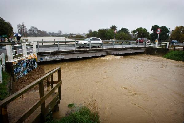 The Mangone Stream in Palmerston North floods after heavy rain.