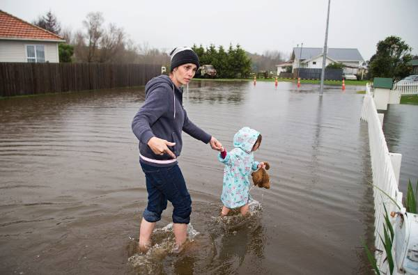Makere Street.  Shyanne Donghi-Johnson, 3 and a half with her mother, Rebecca Johnson, make their way through the water ...