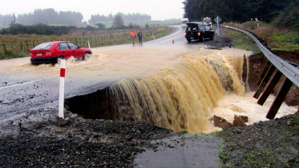 Floodwaters washed out the road in Waituna West.