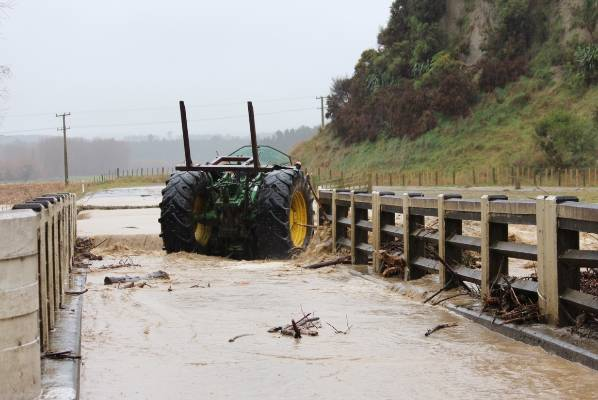 A tractor driver clearing debris on Reu Reu Road in Halcombe had a lucky escape when the road gave way.