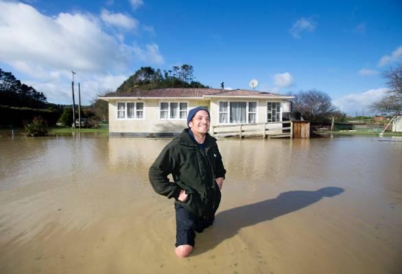 Waitotara man Sid Wyatt wasn't letting a bit of floodwater put him off walking about his town.