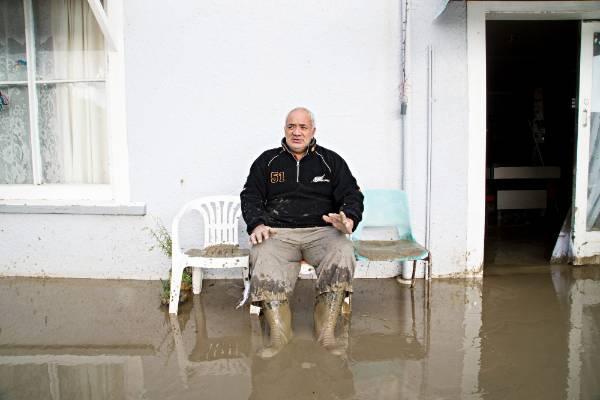 The small South Taranaki town of Waitotara is under water after heavy rains. Resident James Takarangi slept in his car ...