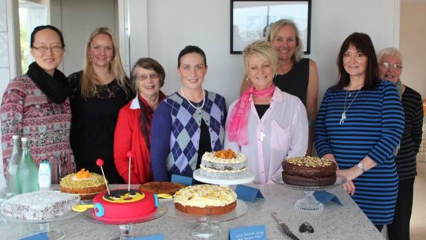 Helen Cox, fourth from left, started a Kiwi Clandestine Cake Club after reading the UK club recipe book.