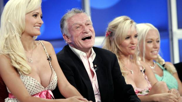 Playboy founder Hugh Hefner surrounded by three of his most famous girlfriends.