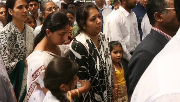 Falguni Mohini and her grieving family at the funeral of slain taxi driver Hiren Mohini.