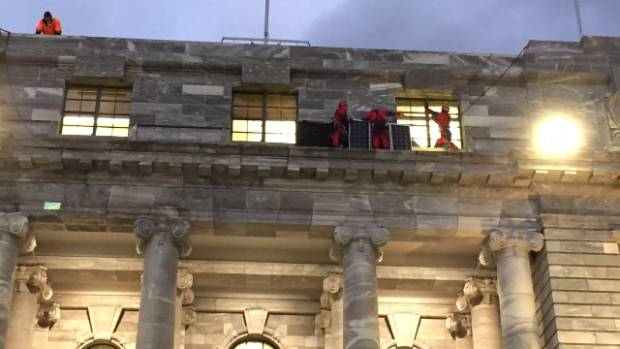 Two men and two women abseiled down onto a ledge and put together a solar panel array.