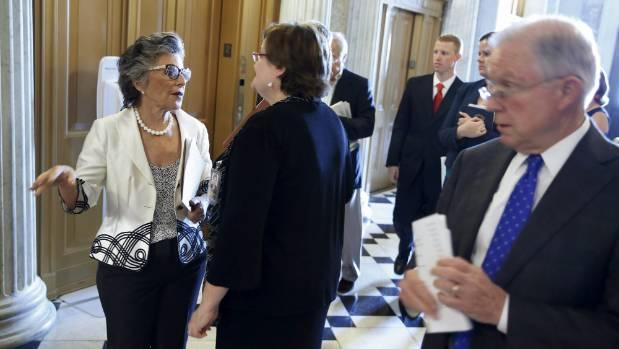 US senators Barbara Boxer (left) and Jeff Session (right) arrive at the US senate for a procedural vote on the ...