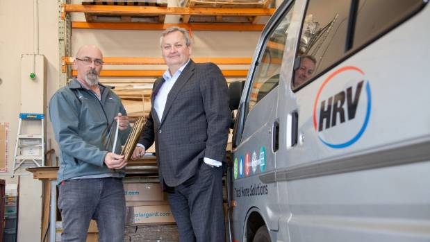 HRV chief financial officer Robert Bell, right, with Jason Pratley - production supervisor of double glazing units.