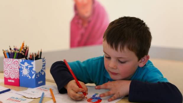George Adams, 6, does his own illustrating.